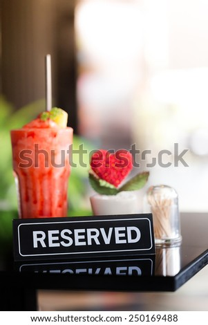 Vintage Styled Image Of A Reserved Sign On A Table In Restaurant - stock photo