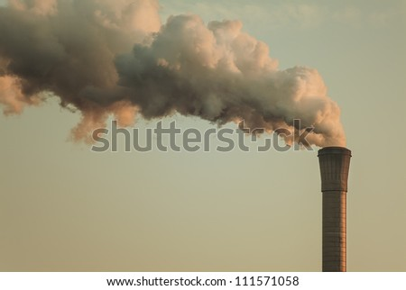 Vintage styled image of air pollution from a factory pipe - stock photo