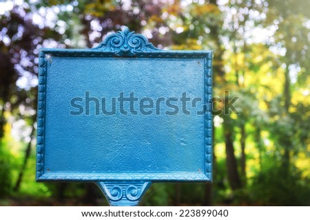Vintage styled sign board in autumn park  - stock photo