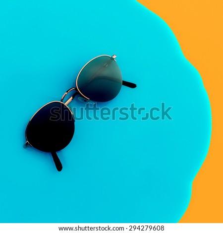 Vintage Stylish Sunglasses on bright background - stock photo