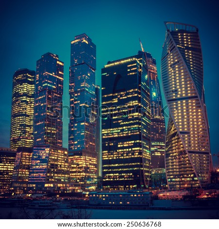 Vintage stylized photo of Night skyscrapers in Moscow
