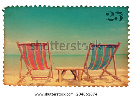 Vintage stylized postage stamp with two beach chairs on tropical shore - stock photo