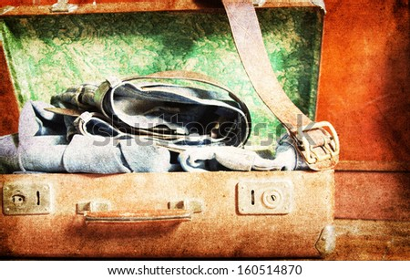 Vintage suitcase a on wooden background - stock photo