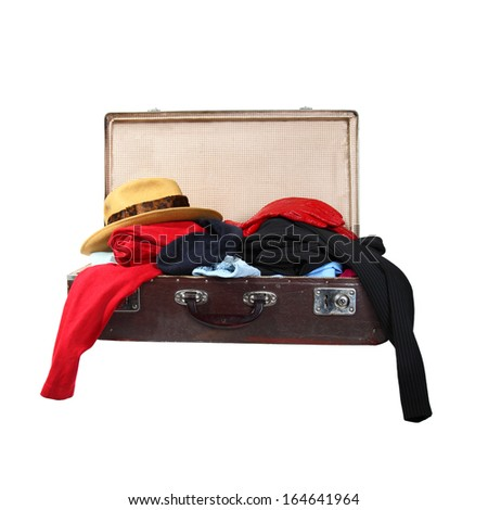 Vintage suitcase full of clothes isolated on white background - stock photo