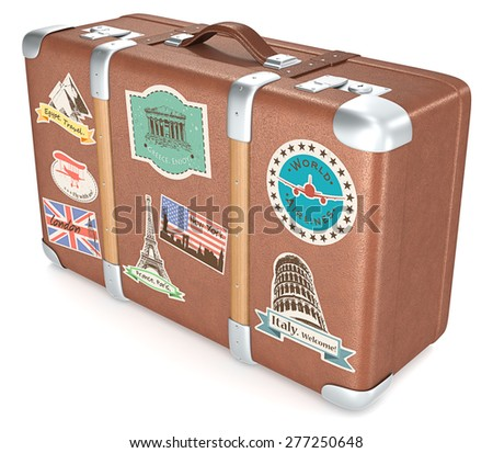 Vintage Suitcase. Leather suitcase with retro travel stickers. - stock photo