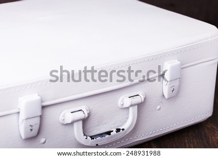 Vintage suitcase painted white paint