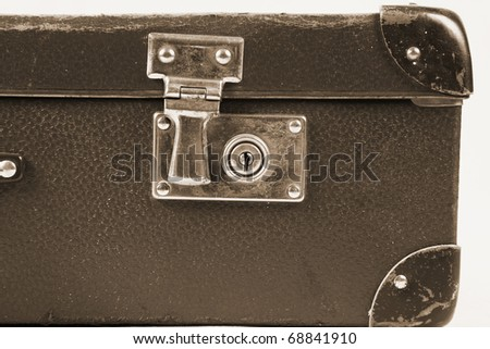 Vintage suitcase with a lock in sepia in close up - stock photo