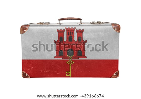 Vintage suitcase with Gibraltar flag - stock photo