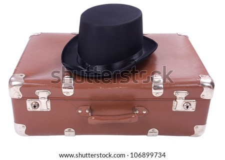 Vintage suitcase with hat over white background