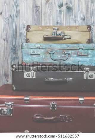 Vintage suitcases,  luggage traveler, selective focus and toned image