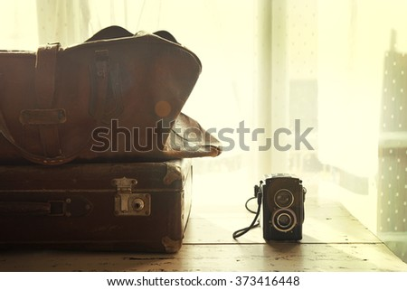 Vintage suitcases with books and camera