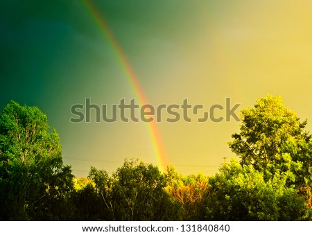 Vintage Summer Landscape With Rainbow and Trees - stock photo