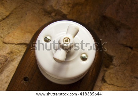 Vintage switch. Antiquated old bakelite white switch
