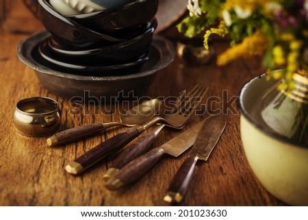 Vintage tableware, cutlery on dark brown wooden backround - stock photo