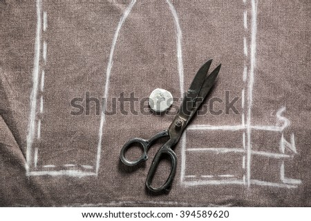 Vintage tailor pattern trousers with cloth and scissors - stock photo