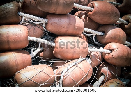 Vintage tangle of fishing nets with big Cork floats - stock photo