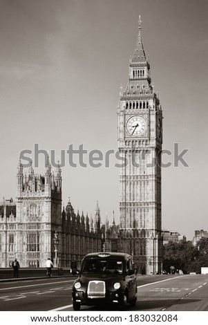 Vintage taxi on Westminster Bridge with Big Ben in London. Black and white - stock photo