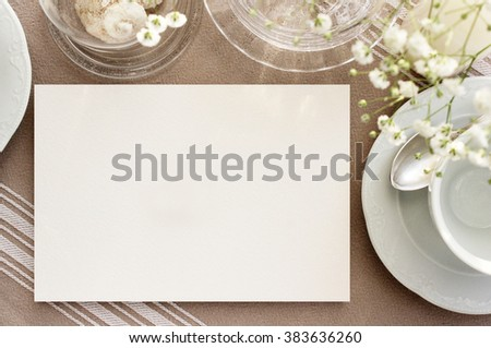 vintage tea invitation mockup. Blank card on a table with vintage dishes for tea. Menu card photo mockup - stock photo