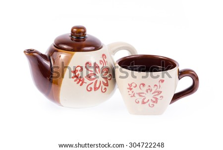 vintage tea pot and tea cup isolated on white background - stock photo