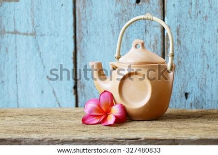 Vintage teapot and plumaria flower