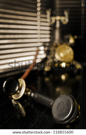 Vintage Telephone - Film Noir Scene with Retro Phone and Blinds - stock photo