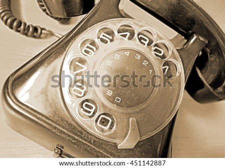 Vintage telephone in sepia