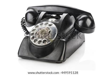 Vintage telephone isolated on a white background - stock photo