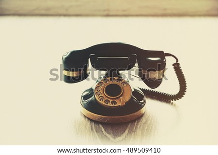 Vintage telephone on floor