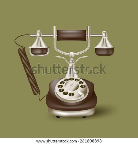 Vintage telephone on green - stock photo