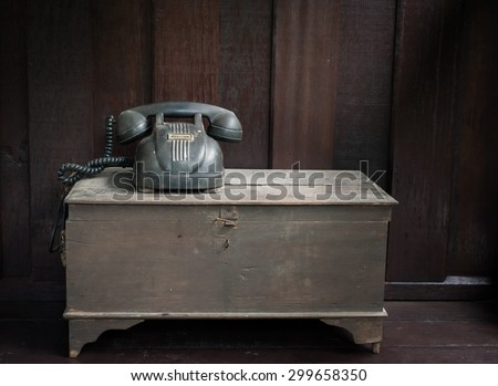 Vintage telephone on old table. - stock photo