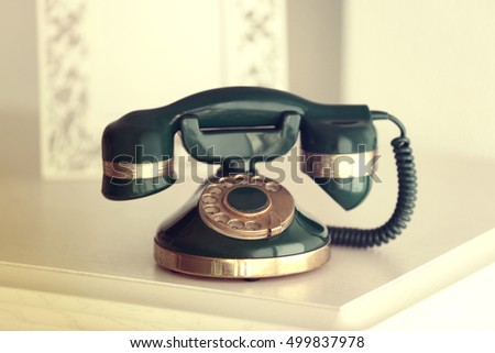 Vintage telephone on white table