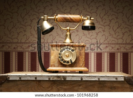 Vintage telephone over retro background - stock photo
