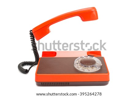 Vintage telephone with rotary dial isolated on white - stock photo