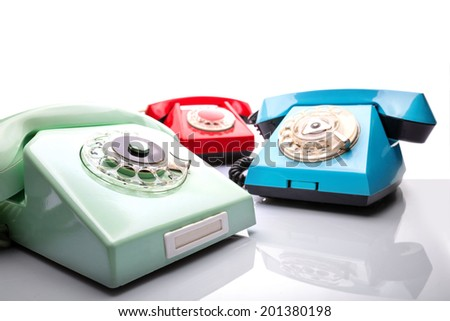 Vintage telephones on white - stock photo