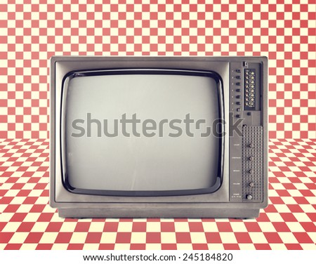 Vintage television isolate on Red checkerboard pattern ,retro technology  - stock photo
