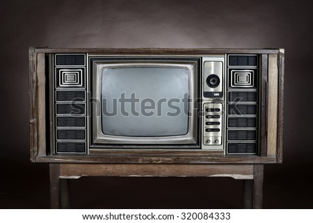 Vintage television on brown background
