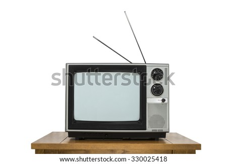 Vintage television on wood table isolated on white. - stock photo
