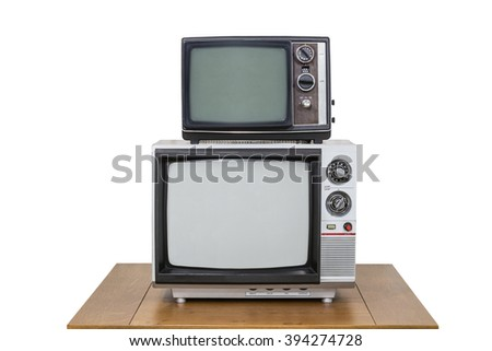 Vintage television stack on old wood table isolated on white.