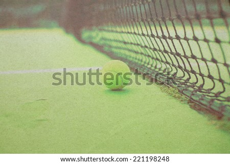 Vintage Tennis ball on tennis court paper picture - stock photo