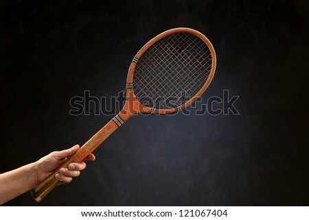 Vintage tennis racket isolated on a neutral background - stock photo