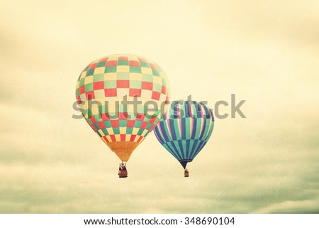 Vintage textured hot air balloons in flight - stock photo