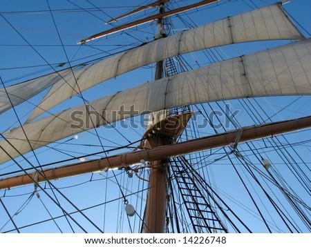 Vintage 19th-century sailing ship mast and sails - stock photo
