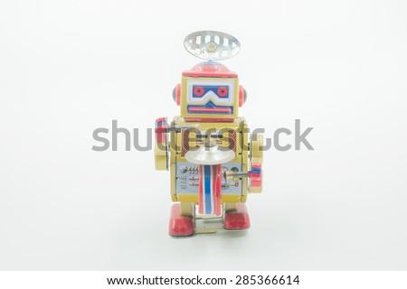 Vintage tin toy robot on white background - stock photo