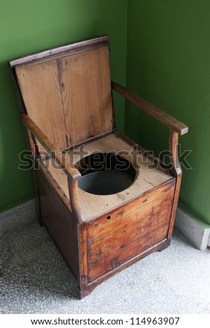 Vintage Toilet Made Of Wooden Armchair And Metal Bucket