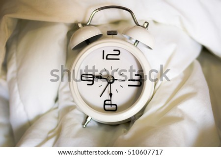Vintage tone alarm clock ,vintage tone alarm clock in the morning on bed