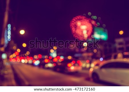 vintage tone blur image of car on street with firework in background night time.