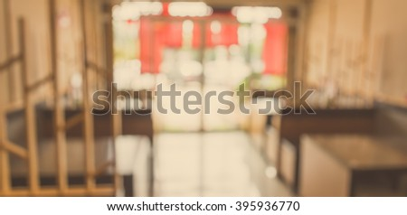 vintage tone blur image of Japanese restaurant in warm tone wooden style. - stock photo