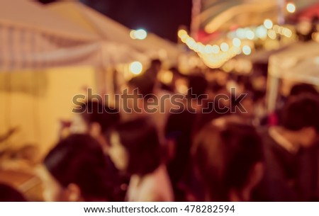 vintage tone blur image of night festival on street blurred background with bokeh.
