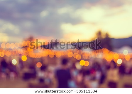 vintage tone blur image of night festival on street  with bokeh for background usage . - stock photo