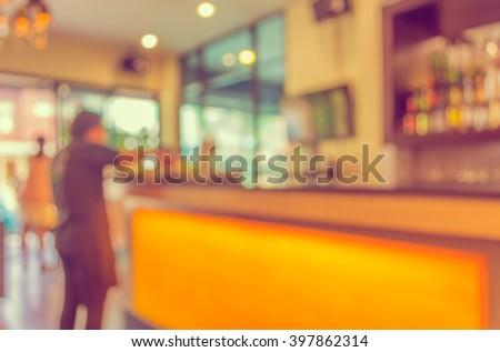 vintage tone  image of blur waitress  service  at  beverage ' s bar for background usage. - stock photo